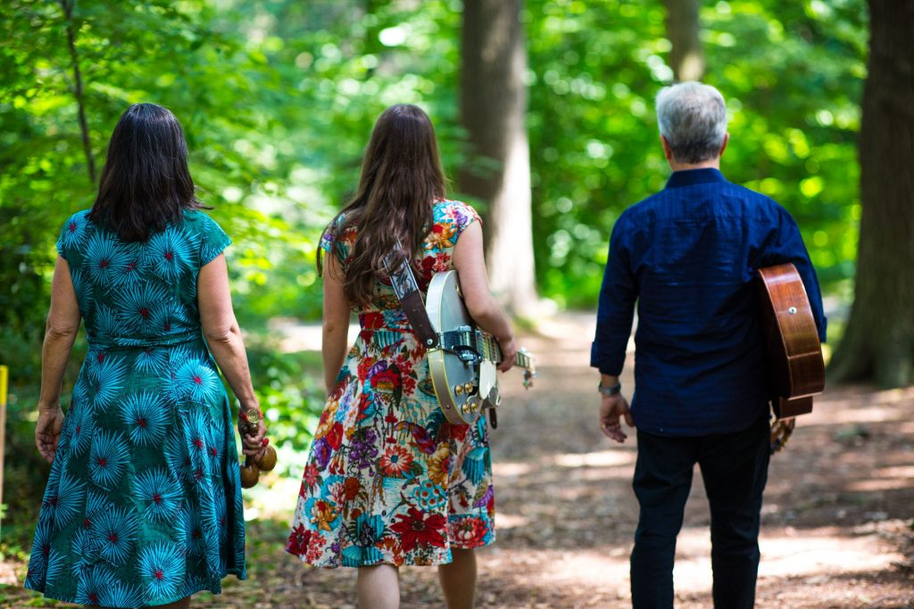 Walking in woods backs to camera